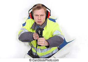 Man in reflective jacket holding power drill