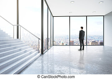 Man in room with stairs