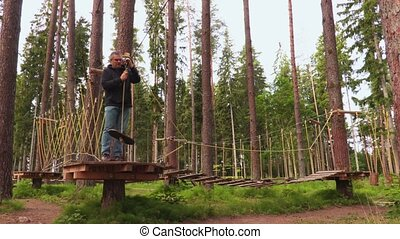 Man in rope course aerial park