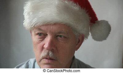 man in Santa hat saying ho ho ho - an older man in a Santa...