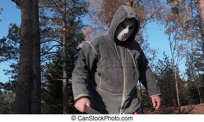 Man in scary Halloween mask using machete