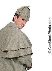 man in Sherlock Holmes costume
