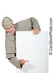 man in Sherlock Holmes costume showing message