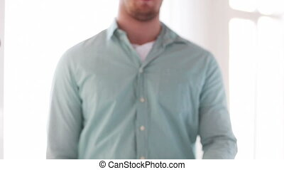 man in shirt showing sign of victory by hand