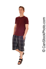 Man in shorts standing.