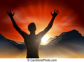 Man in silhouette arms raised on mo - A man at sunrise or...