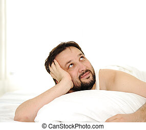 Man in sleeping bed, large space space up