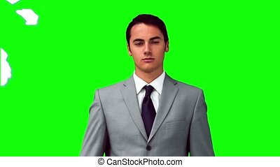 Man in slow motion standing under paper balls