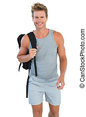 Man in sportswear holding rucksack