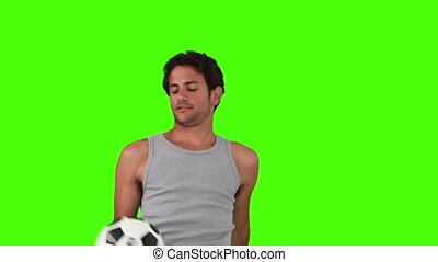 Man in sportswear playing with a soccer ball
