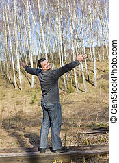 man in spring birch grove