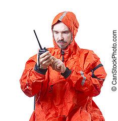 Man in storm cog talking on marine radio.
