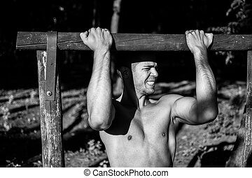 Man in street workout session