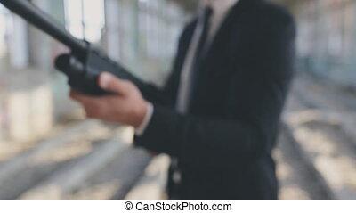 Man in suit aim shotgun