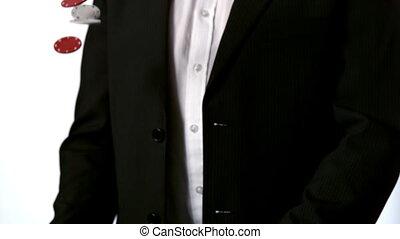Man in suit catching falling casin