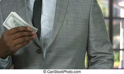 Man in suit counting cash.