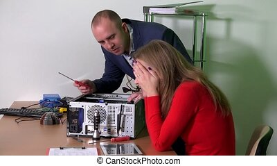 Man in suit help his colleague office girl to repair computer. woman flirting