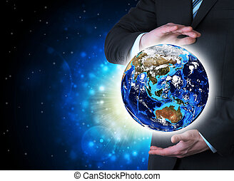 Man in suit holding a earth in hand