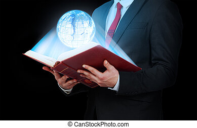 Man in suit holding a opened book with planet hologram. Technology.