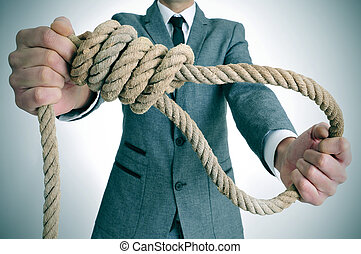 man in suit holding a rope with a hangmans noose - man...