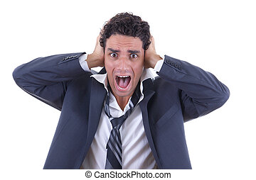 man in suit holding his head and screaming