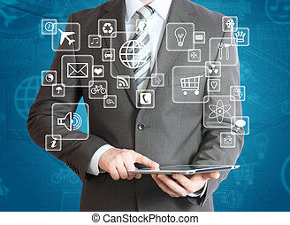 Man in suit holding tablet pc