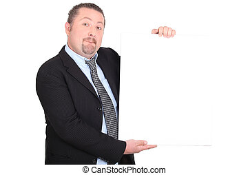 Man in suit holding white sign