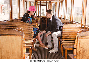 man in suit in the wagon train with smiling woman  look at each