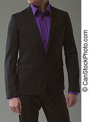 man in suit on a dark background