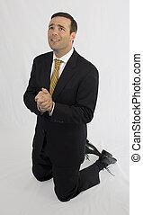 Man in suit on knees begging - Man in black suit on knees...