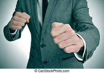 man in suit ready to fight