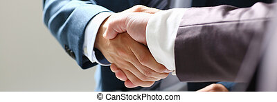 Man in suit shake hand as hello in office closeup. Friend ...