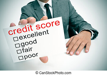credit score - man in suit showing a signboard with the...