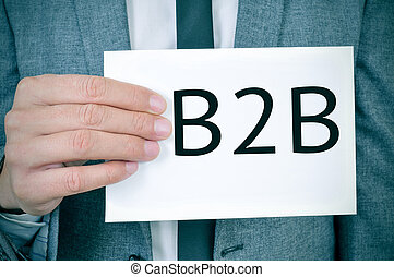 man in suit shows a signboard with the word B2B