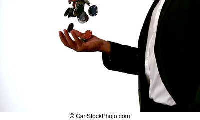 Man in suit throwing and catching c