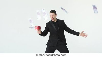 Man in suit throwing money. Successful business or winning the lottery. cash cannon money gun. Slow motion