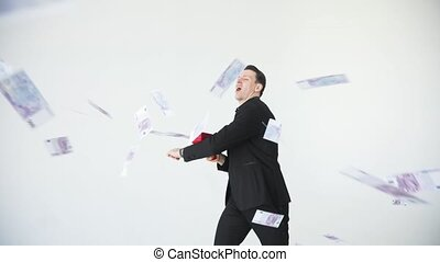 Man in suit throwing money. Successful business or winning...