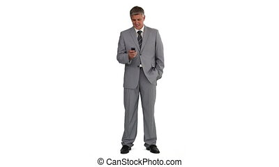 Man in suit using a remote control against a white...
