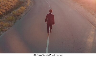 Man in suit walking straight by the road - Confident...