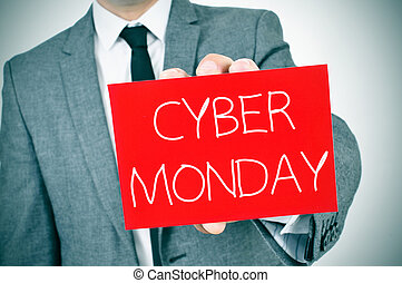man in suit with a signboard with the text cyber monday