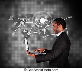 Man in suit working with laptop aga
