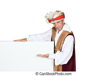 Man in Sultan Fancy Dress Costume with blank board