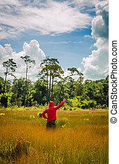 man in summer field