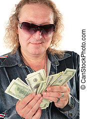 Man in sunglasses with dollars