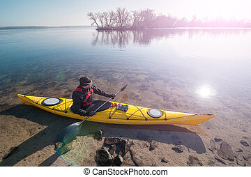 man in sunglasses with the kayak