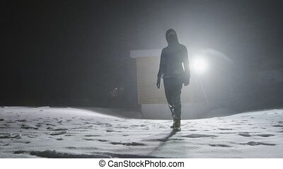 Man in the blizzard at night time