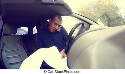 man in the car shouting businessman angry on the phone cursing documents