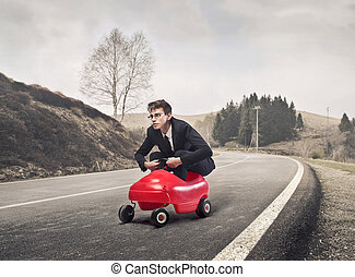 man in the car - young businessman driving a small car