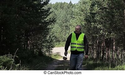 Man in the forest on the road