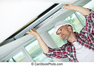 man in the form of construction set ceilings